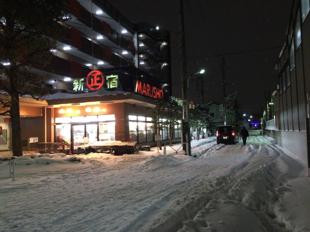Grocery Store Covered in Snow